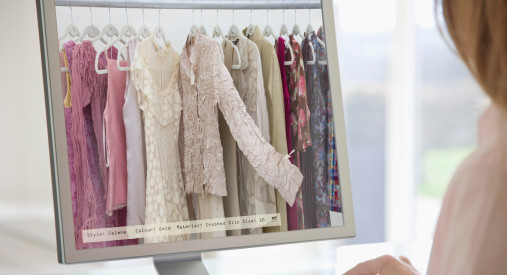 Woman browsing a digital clothes rail on-line